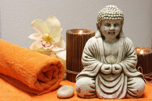 buddha, ručník, svíčky