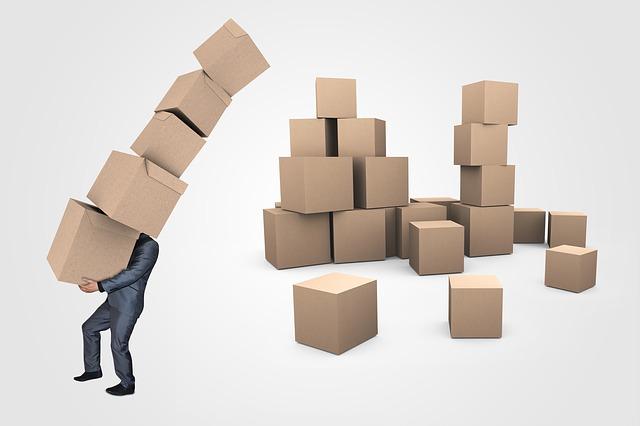 podnikatel s krabicemi